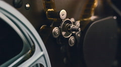 Static shot of an old 16mm movie projector transport gear - stock footage