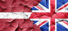 Latvia flag with Great Britain flag on a grunge cracked wall Stock Illustration