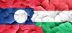 Laos flag with Hungary flag on a grunge cracked wall - stock illustration