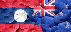 Laos flag with New Zealand flag on a grunge cracked wall Stock Illustration