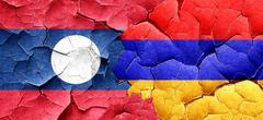Laos flag with Armenia flag on a grunge cracked wall - stock illustration
