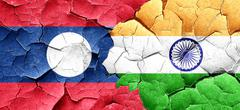 Laos flag with India flag on a grunge cracked wall Stock Illustration