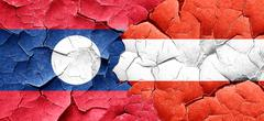 Laos flag with Austria flag on a grunge cracked wall - stock illustration