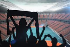 Silhouettes of football supporters against drawing of sports field - stock illustration
