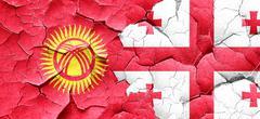 Kyrgyzstan flag with Georgia flag on a grunge cracked wall Stock Illustration