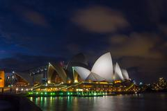 Sydney Opera and harbour bridge at sunset Stock Photos