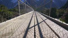 Hiker Walking On Suspension Bridge, Mount Cook National Park Stock Footage