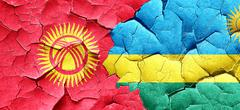 Kyrgyzstan flag with rwanda flag on a grunge cracked wall Stock Illustration