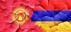 Kyrgyzstan flag with Armenia flag on a grunge cracked wall Stock Illustration