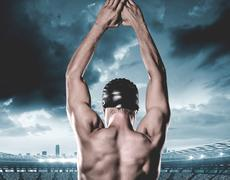 Swimmer preparing to dive against composite image of stadium with cloudy sky Stock Photos
