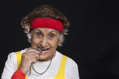 Close-up of senior woman biting locket Stock Photos