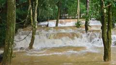 Waterfall in Luang prabang is Tad Sae Waterfall over the turbid water Stock Footage