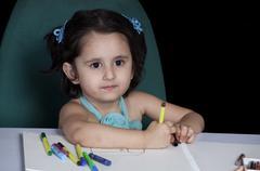 Cute girl holding felt tip pen Stock Photos