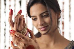 Indian bride wearing bangles Stock Photos