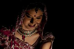 Close-up of Indian bride in wedding attire and jewelery Stock Photos