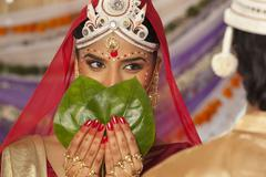 Bengali bride hiding her face from the groom Stock Photos