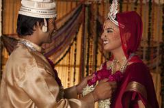 Bengali groom putting a garland on a bride Stock Photos