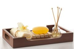 Soap , bath scrub and reed diffuser in a tray Stock Photos