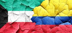Kuwait flag with Colombia flag on a grunge cracked wall - stock illustration