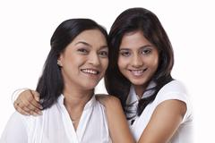 Portrait of smiling mother and daughter Stock Photos