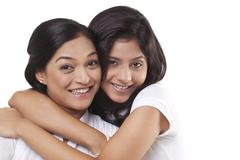 Portrait of happy mother and daughter embracing Stock Photos