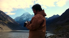 Man Drinking From Thermos While Enjoying Mountain  Scenery Stock Footage