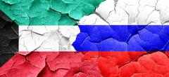 Kuwait flag with Russia flag on a grunge cracked wall Stock Illustration