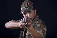 Close-up of male soldier aiming gun Stock Photos