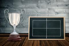 Focus on a trophy against full face black board - stock illustration
