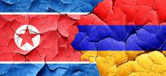 North Korea flag with Armenia flag on a grunge cracked wall - stock illustration