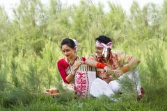 Bihu dancers sitting together Stock Photos