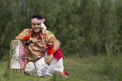 Portrait of a Bihu dancer sitting with a dhol Stock Photos