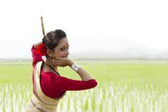 Woman performing Bihu dance Stock Photos