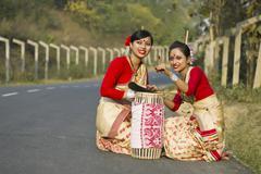 Bihu dancers looking at something Stock Photos