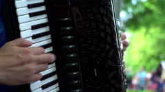 Man plays with accordion in the street, nice close up - stock footage
