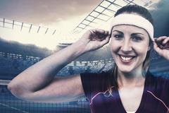 Composite image of female athlete wearing headband and wristband - stock photo
