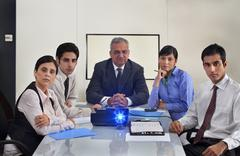 Business people watching a projection presentation Stock Photos