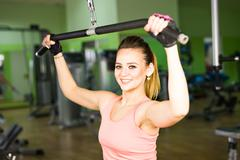 Young woman doing a fitness workout with training apparatus Stock Photos