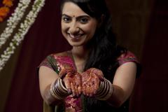 Portrait up of bride's hand with henna tattoo Stock Photos