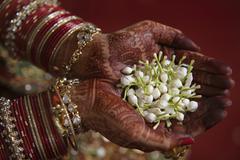 Close-up of bride holding jasmine flower Stock Photos