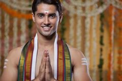 Portrait of South Indian groom greeting Stock Photos