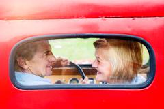 Close up of senior couple inside a pickup truck - stock photo
