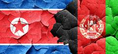 North Korea flag with afghanistan flag on a grunge cracked wall Stock Illustration