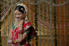 Shy Indian bride looking down and smiling Stock Photos