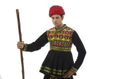 Portrait of a male dandiya dancer with a stick Stock Photos