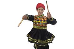 Male dandiya dancer dancing with sticks Stock Photos