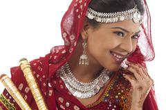 Female dandiya dancer with sticks Stock Photos