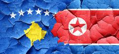 Kosovo flag with North Korea flag on a grunge cracked wall Stock Illustration
