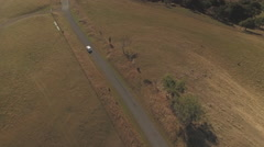 Aerial of Car Driving on Road Stock Footage