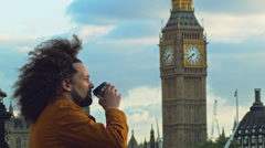 Adult  Male looking at the view at Queen's Walk and the Big Ben in London - stock footage